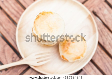 Mini pies on wooden plate, - stock photo