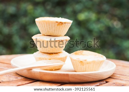 Mini pies on wooden plate - stock photo