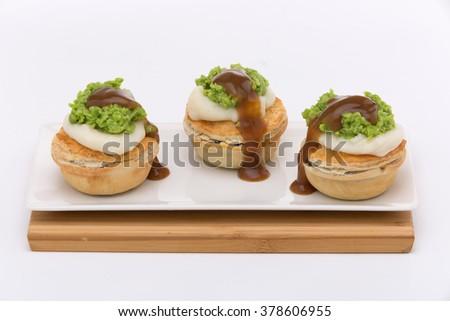 Mini Pies with Peas, Gravy and Potato - stock photo
