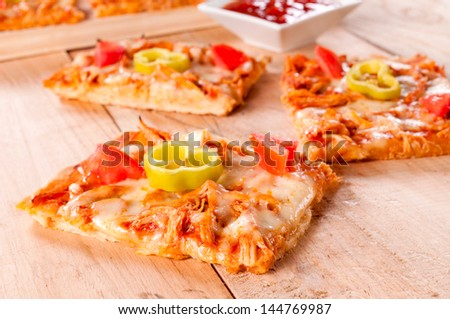Mini pizza sandwiches with white meat and vegetables