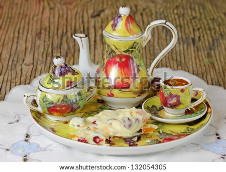 Mini porcelain service for coffee and tea with white chocolate. - stock photo