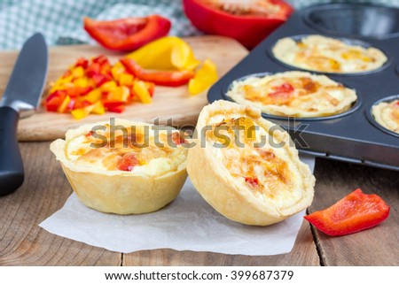 Mini quiche with chicken and bell pepper - stock photo