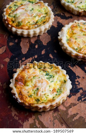 Mini salmon cheese quiches