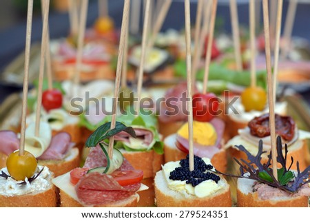 mini sandwiches on a baguette - picnic food - stock photo