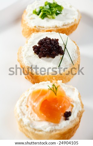 Mini sandwiches -  smoked salmon, caviar and cream cheese - stock photo