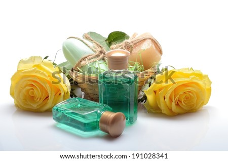 Mini set for spa, sauna bath - small bottles of shampoo, soap and flowers in still life - stock photo