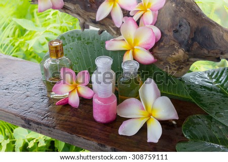 mini set of bubble bath and shower with natural background and flowers - stock photo