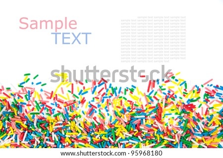 Mini sweet sprinkles  making a border isolated on white background  with sample text - stock photo