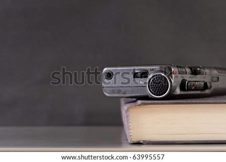 Mini Tape Recorder on Book with Space for Text - stock photo