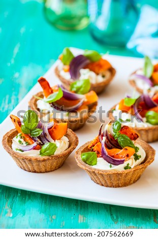 mini tarts with pumpkin and  soft cheese for holiday - stock photo