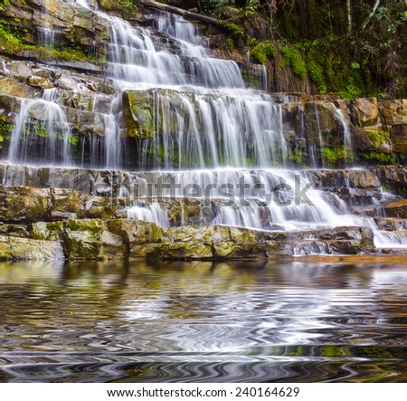 mini waterfall on the stone and reflection - stock photo