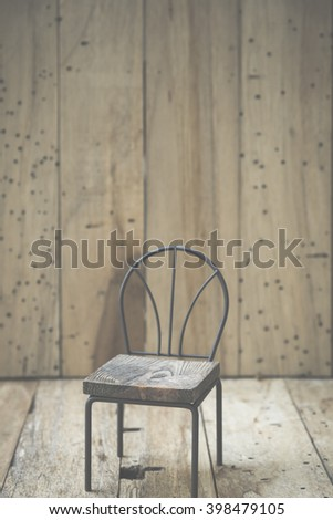 mini wooden chair with wood wall