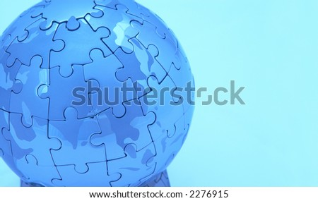 mini world close up on white with blue lighting, space for messages - stock photo