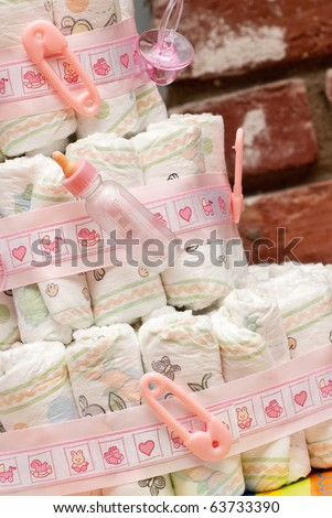 Miniature Baby Bottle on Stacked Diapers ( Baby Shower ) - stock photo