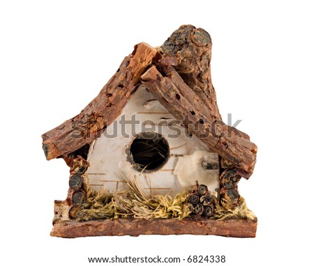 Miniature Birch bark birdhouse on white. - stock photo