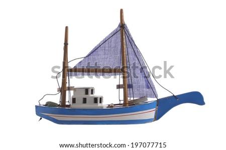 miniature boat model on white background - stock photo