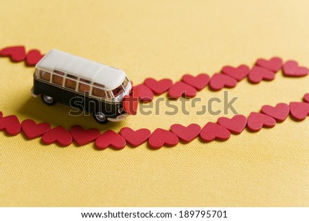 Miniature bus with red hearts - stock photo