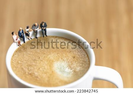 Miniature business team having a coffee break. Macro photo - stock photo
