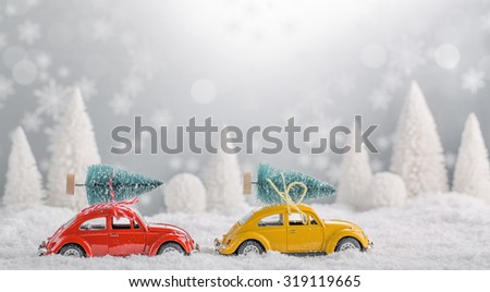 Miniature cars with fir tree on abstract background - stock photo