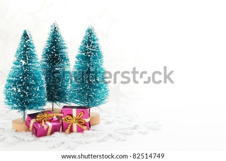 Miniature Christmas Tree and Gifts. - stock photo