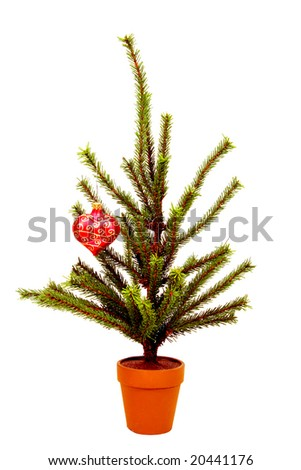 Miniature Christmas tree with one ornament, isolated on white. - stock photo