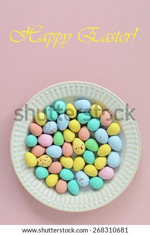 Miniature colored easter eggs on retro plate in vertical format with room for your text on pink background - stock photo