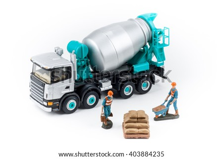 Miniature concrete mixer truck with workers - stock photo