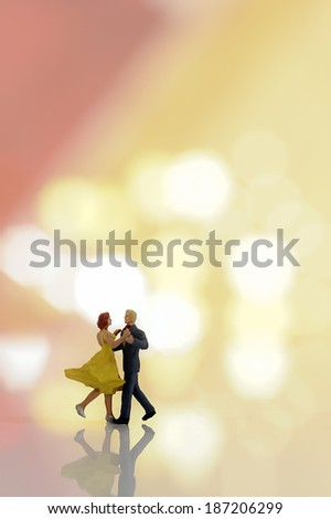 Miniature couple dancing - stock photo