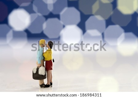 Miniature couple romantic kiss - stock photo