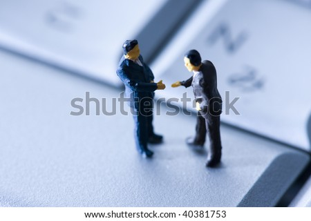 Miniature doll of the worker who gets on the PC. - stock photo