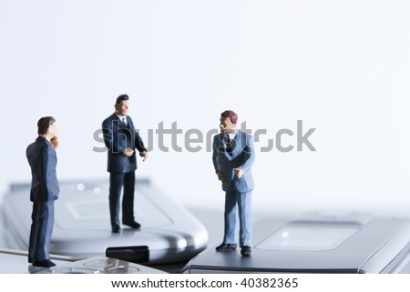 Miniature dolls of the businessman who gets on the cellular phone.