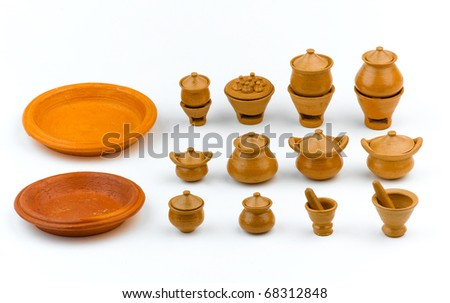 Miniature earthenware toy for children isolated on white - stock photo