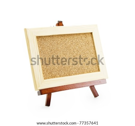 Miniature easel and miniature cork board . Isolated on white. - stock photo