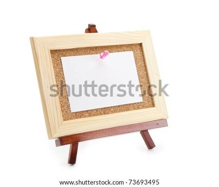 Miniature easel and miniature cork board with blank memo paper, for inserting your message . Isolated on white. - stock photo