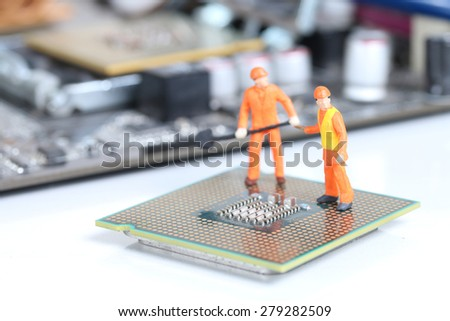Miniature engineer or technician repairing CPU , Technology concept - stock photo
