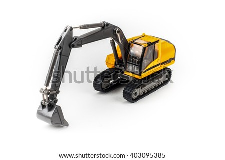 Miniature excavator isolated on white background - stock photo