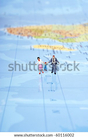 miniature family on travel - stock photo