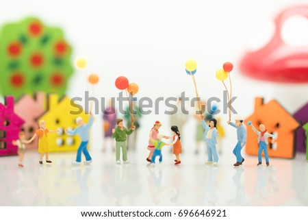 Miniature Family With Balloon Using As Background Day Concept