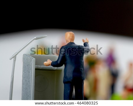 miniature figurine of a politician during a convention or a public speaking of an election rally