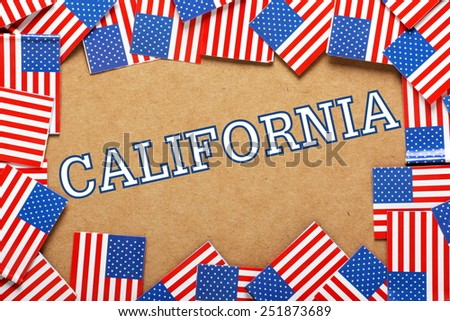 Miniature flags of the United States of America form a border on brown card around the word California