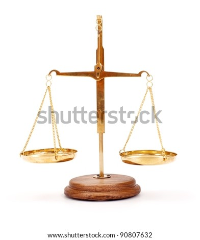 Miniature golden scale on white - stock photo