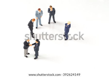 miniature group of businessmen on white background
