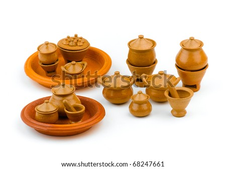Miniature handicraft earth ware toys for kid isolated on white - stock photo