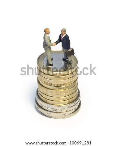 Miniature handshake euro coin tower - stock photo