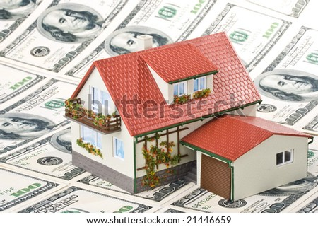 Miniature House and Money. Buying house concept - stock photo