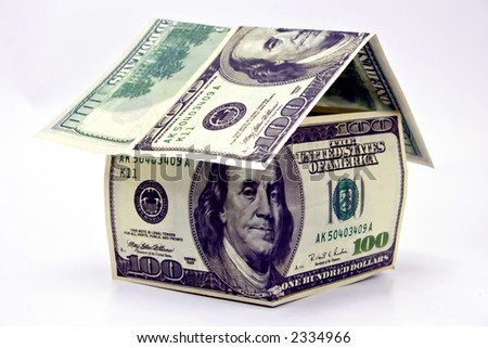 Miniature House made of money - home loan - stock photo