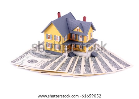 Miniature house over money isolated on white background - stock photo