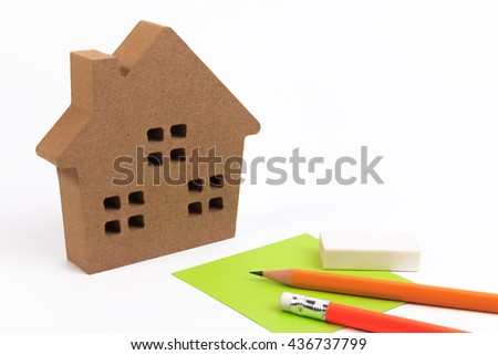 Miniature house, pencil and paper isolated on white. Home ownership.