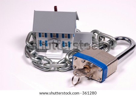 Miniature House With Lock and Chain - stock photo