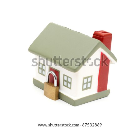 miniature house with lock and chain isolated on white - stock photo